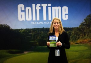 GolfTime Magazine Publisher Kim Thompson shows off the latest issue at the Chicago Golf Show in 2013.