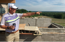 Head Golf Professional Matt Hudson points out the 30-mile view from the new restaurant and clubhouse.