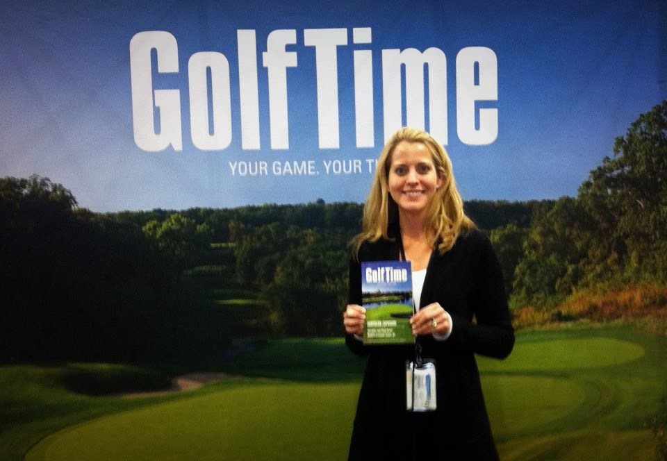 GolfTime Magazine Publisher Kim Thompson shows off the latest issue at the 2013 Chicago Golf Show.